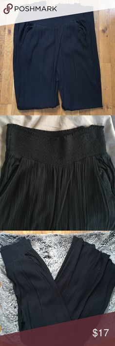 American Eagle Outfitters soft black pants Flowy black pants by American Eagle Oufitters. Wide elastic waist band, trouser style pockets, high waist, crinkled fabric. Only worn a few times, excellent condition. 100% viscose. American Eagle Outfitters Pants
