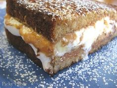These look too sweet. Maybe I'll make them...maybe.Puffy Banana Peanut Butter Cup Sweet Grilled Sandwich | Picky Palate