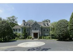 69 Porchuck Road, Greenwich, CT 06831 — Double white gates in scenic backcountry part to this wonderfully private estate of over four acres adjoined by Audubon. A beautifully updated 9000+ sq ft Georgian Colonial with magnificent front to back center hall. Exquisite detail throughout. High ceilings, exceptional large master suite. Seventeen sophisticated and casually elegant rooms on four stories capturing inspiring and far-reaching vistas across tailored lawns, terraces, pool, spa, ...