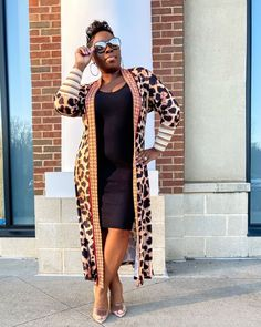 Bodycon dress worn with long leopard printed cardigan | For more style inspiration visit 40plusstyle.com