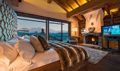 Chalet Trois Couronnes Bedroom Fireplace- Verbier, Switzerland - Home Decorating Trends - Homedit
