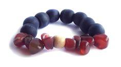 Carnelian stone with wooden navy elastic bracelet. For price visit website. Visit Website, Wooden Jewelry, Carnelian, Bracelet, Navy, Stone, Hale Navy, Rock, Bracelets