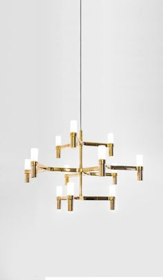Pendant chandeliers, with modular structure in die-casted aluminium and sandblasted glass diffusers. Structure glossy polished, painted in white, matt black or gold. Available a NEMO LED G9 kit for a warm tone. Widespread light. Double switch for versions with more than a level. Transparent cable on all the versions.
