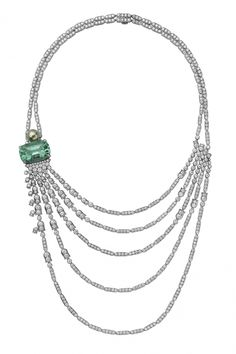 Diamond necklace by Cartier; 5-row diamond necklace with a cushion-shaped green tourmaline and grey-green pearl.