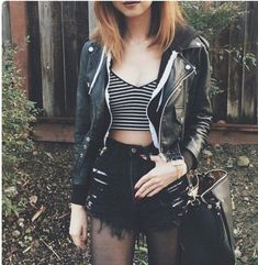 Striped shirt, ripped black shorts and a leather jacket