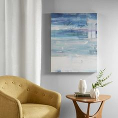 The Urban Mist Grey Gel Coat Canvas features a soothing blend of grey and blue hues to create serene aesthetic in any room. The abstract design is finished with a gel coat to give it a glossy sheen while protecting the colors from fading, while an MDF backing provides a solid structure. Give your home a modern flair by hanging this canvas wall art in your living room or bedroom.
