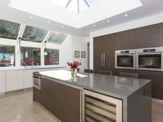 With sleek Italian cabinetry, this Beverly Hills Kitchen in an incredible centerpiece to this home with skylights that bathe the entire area in natural lighting and a gorgeous center island. 2630 Eden Pl | Beverly Hills