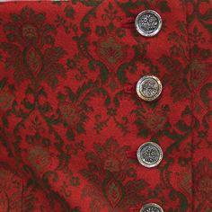 Sehr schönes Trachtenmieder aus rot-grünem Jacquard, mit hübschem Schößchen. Verschlossen wird es mit silbernen Knöpfen vorne. Die Bluse ist nicht dabei. Das Mieder ist kaum getragen und sehr...