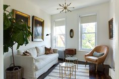 Contemporary Classic Living Room Design Featuring A Linen Covered Sofa, A  Leather Chair, And