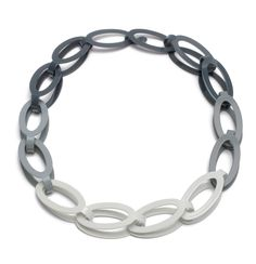 Oval Gradient Chain by Ashley Buchanan. A boldly original and modern accessory. Each link of this oversized chain is individually cut and formed from brass sheet metal, then powder coated, in a gradient of monochromatic hues.