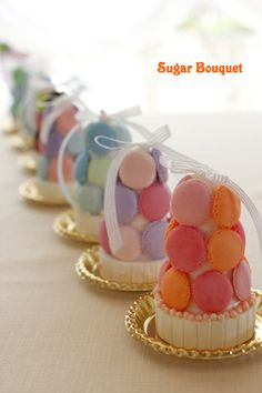 I love these mini macaron shell towers. Will definitely make these at my bakery.