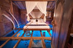 The Udang House, for example, is one of the most unique vacation homes in Bali. Situated above a fresh shrimp pond, this Bambu Indah favorite showcases a tempered glass floor not unlike the one we saw on Patrick Blanc's home office. Relax and watch the shrimp swim in the comfort of your house - a once in a lifetime experience. This bedroom shot intrigued us so much that we ended up looking for the photographer behind it. We were not disappointed. Check out the making of this scene in the ...