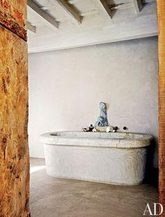 Rustic Bathroom by Axel Vervoordt and Alessio Lipari Architects and Serena Mignatti Architect in Rome, Italy