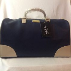 Nicole Miller duffle travel bag. This duffle bag is a Must for your upcoming holiday travel. It's elegant, gorgeous and can carry a huge amount of your belongings during your trip. The pictures are not able to show how beautiful it is. The color is navy with bone colored trim. High quality Man made materials. External side pockets. Length is 21.5 width is 9.5 and height is 12.5. Simply stunning. Thanks for visiting. Nicole Miller Bags Travel Bags