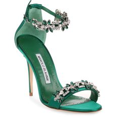 Emerald satan embellished sandal from Manolo Blahnik. The Firadou has a stiletto heel, clear and emerald crystal detailing, and an adjustable ankle strap.True to sizeLeather soleMade in Italy Green Heeled Sandals, Embellished Heeled Sandals, Shoes Sandals, Strap Sandals, Green Pumps, Sapatos Manolo Blahnik, Manolo Blahnik Sandals, Ankle Strap High Heels, High Heels Stilettos