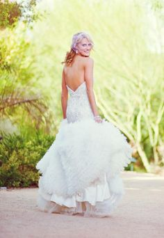 Gorgeous feathered wedding dress with a V-back | Chelsea Nicole Photography