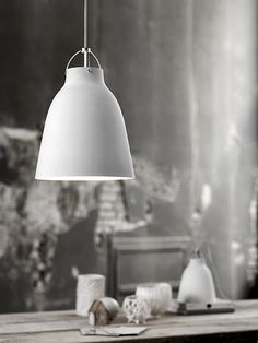 Caravaggio pendant by Fritz Hansen charms with the elegance of light grey, matt-lacquered shade. Designed by Cecilie Manz, Caravaggio lamp features a deep shade which prevents glare, and an opening at the top, allowing the light to cast also upwards. Caravaggio, Beautiful Interior Design, Beautiful Interiors, Home Interior Design, Interior Lighting, Lighting Design, Helsinki Design, Pendant Lamp, Pendant Lighting