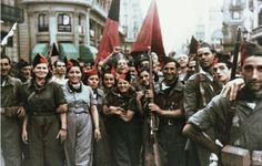 "Colorized photograph of anarchists in the Spanish Civil War ""The hillsides ring with 'free the people'/Or can I hear the echo of the days of '39?/With trenches full of poets, a ragged army/Fixin' bayonets to fight the other line"""