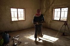 The bomb maker Abdallah holds a home made IED (improvised explosive device) which will be detonated in specific area to cut access to their mountainous stronghold in the northern Syrian province of Idlib on March 20, 2012.