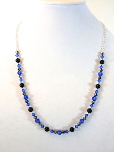"Black 'n Blue  $30.00 Sapphire and crystal silver night Swarovski crystals and black Swarovski pearls will add dazzle and shine to any wardrobe.  About 14"" of Swarovski and 12"" of chain.  #handmade #jewelry #bracelet #necklace #earrings #swarovski"