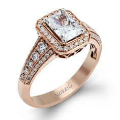 Amazing Rose Gold Emerald Diamond Halo Engagement Ring from @simongjewelry