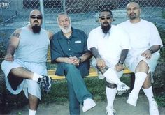 "Peter ""Sana"" Ojeda (second from l.) is seen in federal prison with his Mexican Mafia ""carnals"" (brothers)."