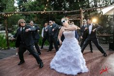 Cara and Patrick mixing it up with their groomsmen at Hidden Creek!  Gotta love a choreographed dance number at a reception!  photo by Zook Photography #rusticwedding #LakeArrowhead