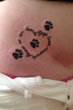 "My first tattoo ! I love it.. Can't stop looking at it hahaha. #tattoo#dogs#love#animals#vettech#heart ""Dogs leave pawprints forever on our hearts"""