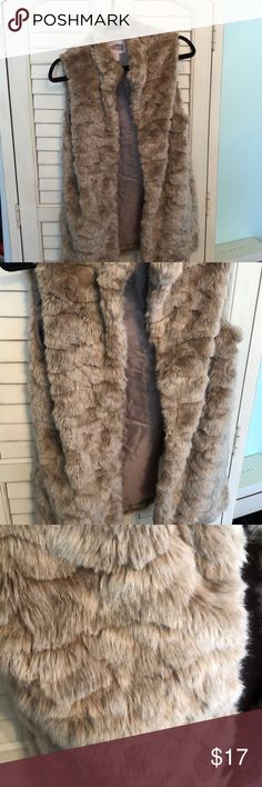 NWOT Soft Brown Faux Fur Vest Super adorable & SOFT brown fur vest (faux). As you can tell, it's in perfect condition & NWOT. The fur has a cute print on it. It's perfect for any season- perfect for layering!! & honestly very flattering. I just have never worn it so it needs a new home!! Would look cute with a striped shirt & white jeans & booties for spring!!✨ I bought from forever 21 contemporary line so it's very nice quality. Inside is a silk lining. forever 21 contemporary Jackets…