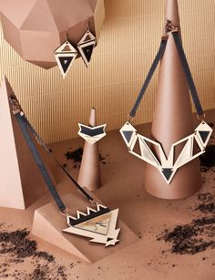 "Jewelry collection ""Ethnotize"" by Rename. Laser cut wood with black and gold perspex. Photo by Marijana Gligic."