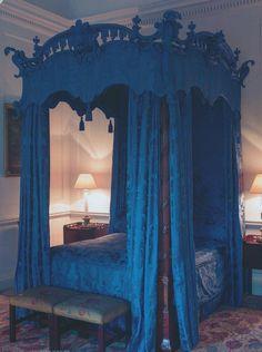 Beautiful blue heavy drapes on canopy bed