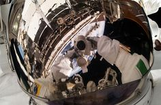 ESA astronaut Luca Parmitano, Expedition 36 flight engineer, used a digital still camera to snap a photo of his helmet visor during a session of extravehicular activity (EVA) on the International Space Station's exterior. This was Parmitano's first career EVA.