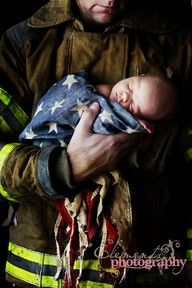 Fireman with Baby in an American Flag.