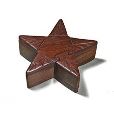 @Overstock - Finely carved wooden sculpture hides its contents well  Star shaped sculpture is also a 3D puzzle box  Four-piece star box features one hidden compartmenthttp://www.overstock.com/Worldstock-Fair-Trade/Wooden-Fair-Trade-Star-Puzzle-Box-India/4359835/product.html?CID=214117 $20.99