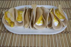These crepes look a bit like tacos and are a tasty and popular street food dessert in Thailand. We have stuffed ours with whipped cream and Foi Thong! Thai Dishes, Food Dishes, Food Food, Crepe Recipes, Dessert Recipes, Pancake Recipes, Thai Recipes, Asian Recipes, Cooking Recipes