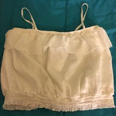 Ivory Eyelet Crop Tank XL Almost Famous Super cute ivory crop tank top. Eyelet lace with ruffle neckline.  Size XL. Almost Famous.  Excellent condition.   Important:   All items are freshly laundered as applicable prior to shipping (new items and shoes excluded).  Not all my items are from pet/smoke free homes.  Price is reduced to reflect this!   Thank you for looking! Almost Famous Tops Tank Tops