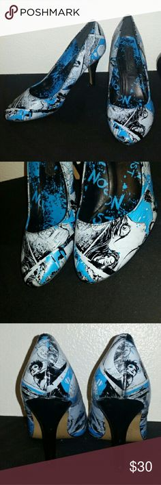 Iron Fist Comic Book Heels Iron Fist Brand blue/black/white comic book themed heels. I've had these for around 10 years I think so there is some definite wear (small scratches, scuffs) but nothing too major. I would still wear them but they aren't my style anymore. The pics are unedited so what you see is what you get. Iron Fist Shoes Heels