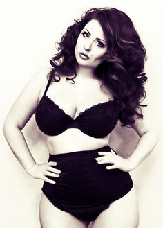 Who says you have to be a size 2 to considered beautiful? LOVE her Body! Love her curves.