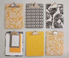 These fabric- or scrapbook paper-covered clip boards would be a great way to organize shopping lists, due dates, to do lists, chores, etc., while keeping a space attractive