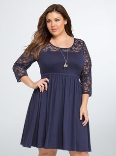"<p>Navy blue knit covers this long sleeved skater dress, providing the feel of a favorite tee (in dress form). A stretchy gathered waistband lends fit and flare flavor to the dress, while a lace inset along the collar and sleeves is totes romantic. Button back.</p>  <p> </p>  <p><b>Model is 5'9"", size 1</b></p>  <ul> 	<li>Size 1 measures 41"" from shoulder</li> 	<li>Polyester/rayon/spandex/nylon</li> 	<li>Hand wash cold, dry flat</li> 	<li>Imported plus size dress</li> <..."