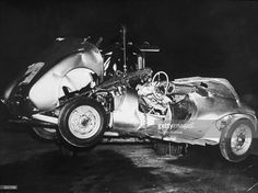 The mangled remains of 'Little Bastard,' James Dean's Porsche Spyder sports car in which he died during a high-speed car crash, being towed by a tow truck, California.