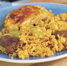 Arroz con Pollo   I like this recipe!!  I use boneless, skinless chicken thighs and hot Italian sausage.  Yum.