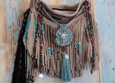 Handmade wearable art from AlisoBay. Native american style leather fringe bag. Spring '18 collection