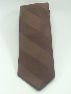 A personal favorite from my Etsy shop https://www.etsy.com/listing/223241742/brown-stripped-necktie-texturized
