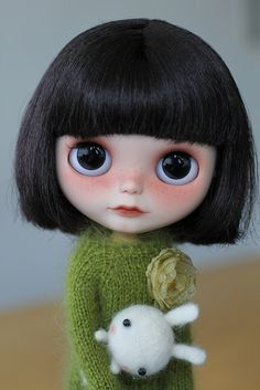 internationaldollhouse.com when I was growing I had this hair cut BUT since I have curly hair It was the curly type version.