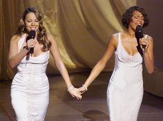 Mariah Carey and Whitney Houston on stage during the Oscars in 1999