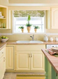 I wish I'd paint a yellow kitchen. Maybe at least the walls to match with white cupboards. Fresh Citrus: Window Dressing- A light green and white Roman shade makes the greenhouse window above the sink the focal point of the room. Yellow Kitchen Cabinets, Kitchen Paint, Kitchen Redo, Kitchen Backsplash, New Kitchen, Backsplash Ideas, Kitchen Benchtops, White Cupboards, Kitchen Ideas