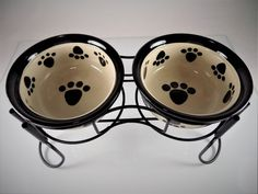 #Ceramic #dog and #cat #pet food and water #bowl three (3) piece/count pc. ct. set with solid black metal stand, super cute #paw print, beige/tan and black colors, black rim, shiny outer glaze, and a size that's perfect for #puppy #puppies and small to medium #dogs and cats, excellent used condition http://www.ebay.com/itm/EUC-CERAMIC-DOG-CAT-PET-FOOD-WATER-BOWL-SET-with-STAND-PAW-PRINT-BEIGE-BLACK-3pc-/112454273913?hash=item1a2ecc0b79