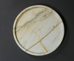 Round marble tray made of one piece of Calacatta marble hand