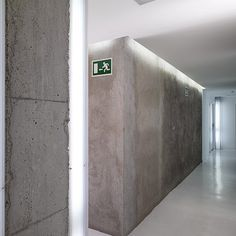 View of the interior corridor of the Mellon District student rooms in Barcelona, Spain by architect Gus Wustemann. Nice mix of clean and rough materials. I also like the lighting.